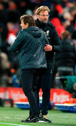 Chelsea manager Antonio Conte (left) and Liverpool manager Jurgen Klopp shake hands
