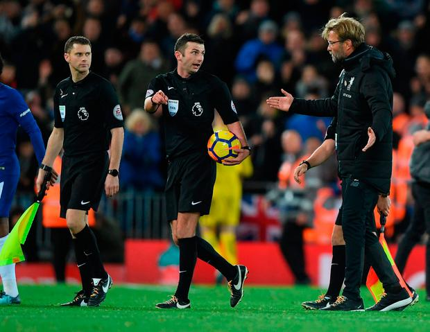 Jurgen Klopp confronts referee Michael Oliver after the Premier League match between Liverpool and Chelsea at Anfield