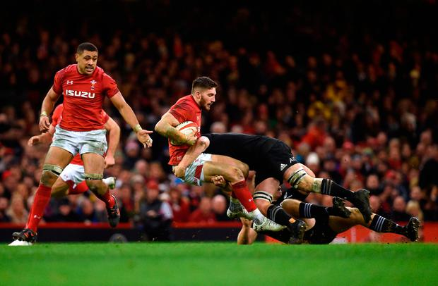 Wales' Owen Williams is tackled by New Zealand's Sam Cane (right)