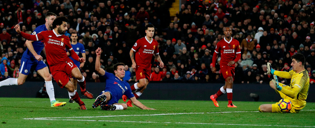 Liverpool's Mohamed Salah takes one touch before beating Thibaut Courtois with a clinical finish inside the near post.. Photo: Phil Noble/Reuters