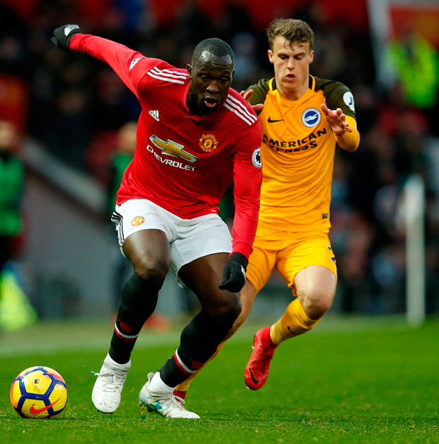 Manchester United's Romelu Lukaku in action with Brighton's Solly March. Photo:/Andrew Yates/Reuters