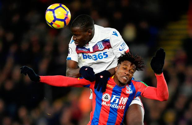Stoke City's Kurt Zouma in action against Crystal Palace's Wilfried Zaha. Photo: Tony O'Brien/Reuters