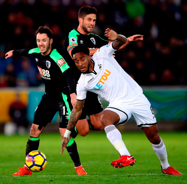 AFC Bournemouth's Adam Smith (left) and Andrew Surman battle for the ball with Swansea City's Leroy Fer during their Premier League match at the Liberty Stadium. Photo: Nick Potts/PA