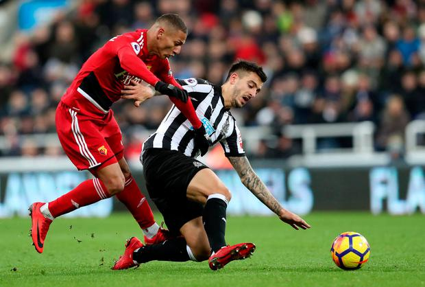 Watford's Richarlison battles for the ball with Newcastle United's Joselu. Photo: Scott Heppell/Reuters