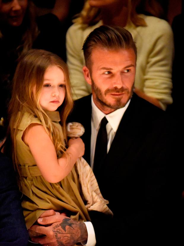 Defensive: David Beckham defended kissing six-year-old daughter Harper on the lips by saying he kisses his sons similarly