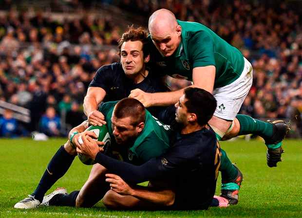 CJ Stander, supported by Devin Toner, scores his side's third try. Photo: Ramsey Cardy/Sportsfile