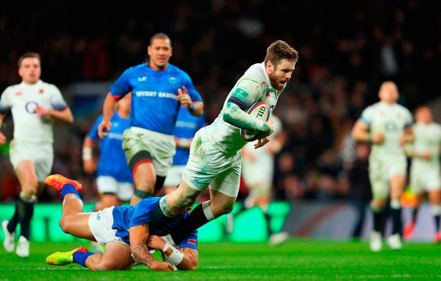 Elliot Daly of England crosses for the sixth try Photo: Getty