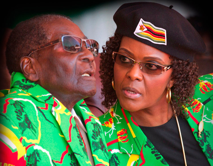 LEADING LADY: Robert Mugabe and his wife Grace follow proceedings during a youth rally in Zimbabwe Photo: AP