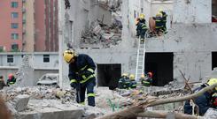 Rescue workers work at the site of a blast in Ningbo, Zhejiang province, China November 26, 2017. REUTERS/Stringer
