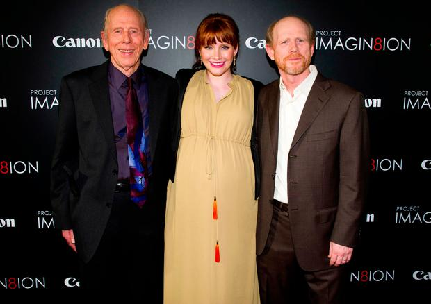 Ron Howard, right, his daughter Bryce Dallas Howard and his father Rance Howard attend the premiere of