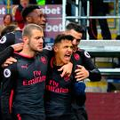 Arsenal's Alexis Sanchez celebrates scoring his side's first goal of the game during the Premier League match at Turf Moor, Burnley. PRESS ASSOCIATION Photo. Picture date: Sunday November 26, 2017. Photo credit should read: Martin Rickett/PA Wire.