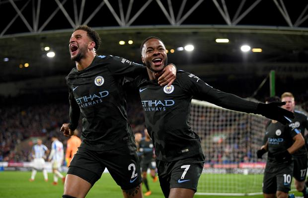 Raheem Sterling of Manchester City celebrates scoring the 2nd Manchester City goal with Kyle Walker of Manchester City during the Premier League match between Huddersfield Town and Manchester City at John Smith's Stadium on November 26, 2017 in Huddersfield, England. (Photo by Shaun Botterill/Getty Images)