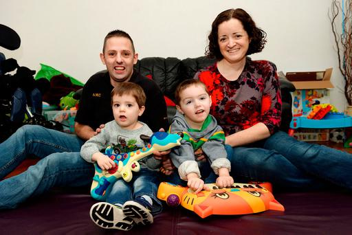 Anthony and Jean McCallig with their sons Daniel (2), left, and Eoin (5), in Killybegs, Co Donegal. Photo: Caroline Quinn