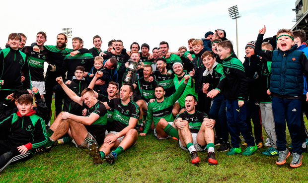 Nemo Rangers players celebrate with the cup. Photo: Sportsfile