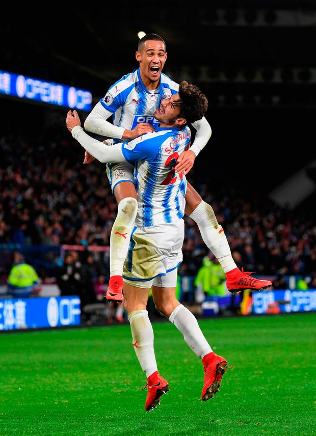 Tom Ince and Christopher Schindler of Huddersfield Town celebrate after Nicolas Otamendi of Manchester City scored the an own goal Photo: Getty
