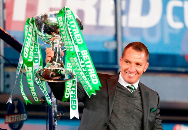 Celtic manager Brendan Rodgers celebrates with the trophy after winning the Betfred Cup Photo: PA