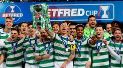 Celtic's Scott Brown and team mates celebrate with the trophy after winning the Scottish League Cup Photo: Reuters