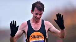 Paul Pollock celebrates as he crosses the line to win the senior men's race yesterday Photo: David Fitzgerald/Sportsfile