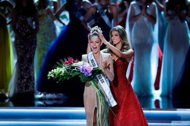 Miss South Africa Demi Leigh Nel-Peters reacts as she is crowned by Miss Universe 2016 Iris Mittenaere during the 66th Miss Universe pageant at Planet Hollywood hotel-casino in Las Vegas Nevada