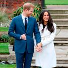 Prince Harry and actress Meghan Markle during an official photocall to announce their engagement at The Sunken Gardens at Kensington Palace on November 27, 2017 in London, England