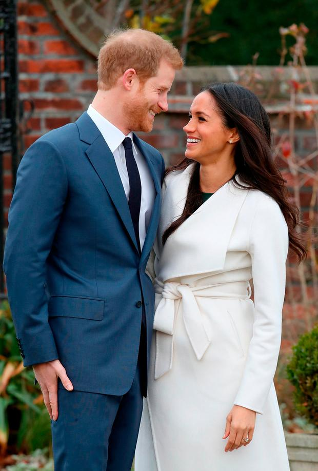 Prince Harry and actress Meghan Markle during an official photocall to announce their engagement at The Sunken Gardens at Kensington Palace on November 27, 2017 in London, England. Prince Harry and Meghan Markle have been a couple officially since November 2016 and are due to marry in Spring 2018. (Photo by Chris Jackson/Chris Jackson/Getty Images)