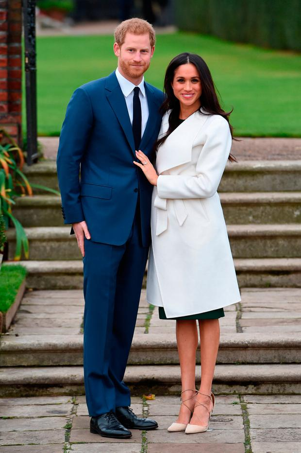 Prince Harry and actress Meghan Markle during an official photocall to announce their engagement at The Sunken Gardens at Kensington Palace on November 27, 2017 in London, England. Prince Harry and Meghan Markle have been a couple officially since November 2016 and are due to marry in Spring 2018. (Photo by Eddie Mulholland-WPA Pool/Getty Images)