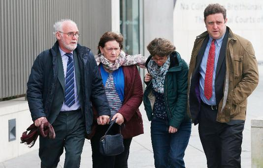 Victim's father, Bartley Molloy (left) pictured leaving Dublin Central Criminal Court with family and friends after Raymond Walsh pleaded guilty to murder