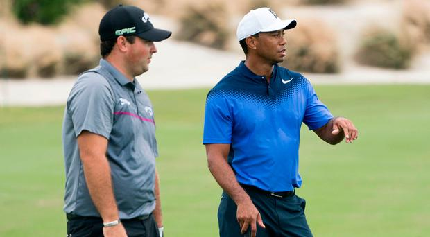 Tiger Woods talks to Patrick Reed on the fourth hole during Monday's practice round. Photo: Kyle Terada USA Today Sports