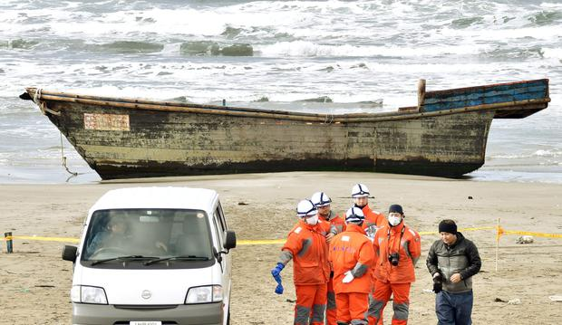 A wooden boat, which drifted ashore with eight partially skeletal bodies and was found by the Japan Coast Guard, is seen in Oga