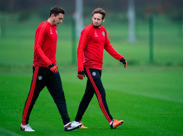 Manchester United's Dutch midfielder Daley Blind (R) and Manchester United's Italian defender Matteo Darmian arrive to attend a team training session in Manchester, north west England, on November 24, 2015, ahead of their UEFA Champions League Group B football match against PSV Eindhoven on November 25. AFP PHOTO / OLI SCARFF / AFP / OLI SCARFF