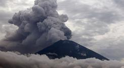 Clouds of ashes rise from the Mount Agung volcano erupting in Karangasem, Bali, Indonesia, Tuesday, Nov. 28, 2017. (AP Photo/Firdia Lisnawati)