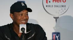 Tiger Woods addresses the media after yesterday's practice round at the Hero World Challenge tournament. Photo: USA TODAY Sports