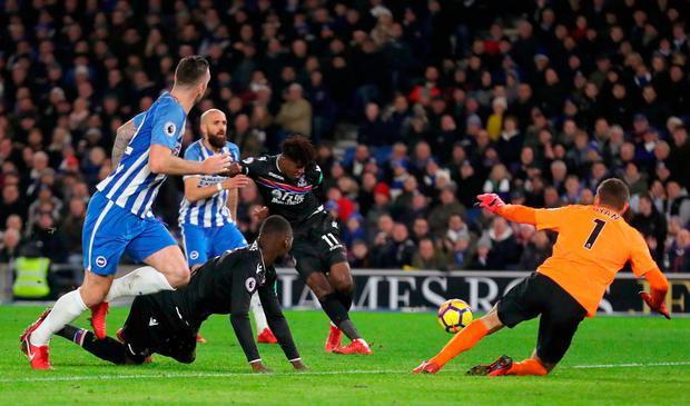 Crystal Palace's Wilfried Zaha scores but it is later disallowed. Photo: PA