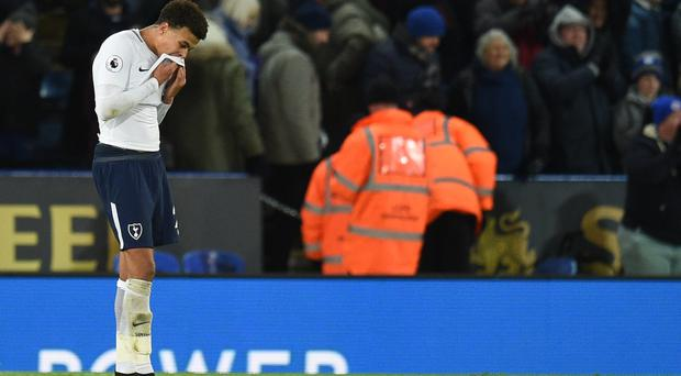 Tottenham midfielder Dele Alli cannot hide his frustration at the final whistle as his side lose 2-1 at Leicester (Photo credit should read OLI SCARFF/AFP/Getty Images)
