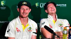 Australia's captain Steve Smith reacts as team mate Cameron Bancroft speaks during a media conference after the first Ashes test in Brisbane. Photo: Reuters