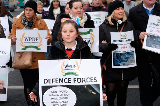 Alisha Mahon (11) from Lucan, Dublin, leads the wives and partners of the Defence Forces in a protest at Leinster House. Photo: Justin Farrelly