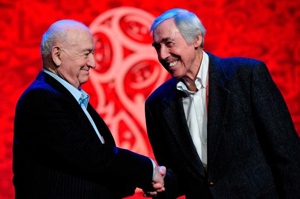 Draw assistants: Nikita Simonyan, former USSR forward and coach, shakes hands with Gordon Banks, former England's goalkeeper, as they pose on the stage of the State Kremlin Palace in Moscow on November 30, 2017 on the eve of the Final Draw for the 2018 FIFA World Cup. / AFP PHOTO / Mladen ANTONOVMLADEN ANTONOV/AFP/Getty Images