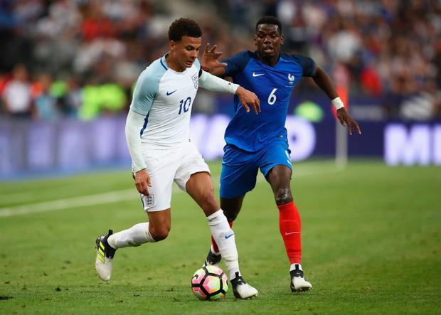 PARIS, FRANCE - JUNE 13: Dele Alli of England holds off Paul Pogba of France during the International Friendly match between France and England at Stade de France on June 13, 2017 in Paris, France. (Photo by Julian Finney/Getty Images)