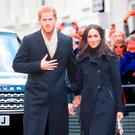 Prince Harry and Meghan Markle meet well-wishers as they arrive at the Nottingham Contemporary in Nottingham, to attend a Terrence Higgins Trust World AIDS Day charity fair on their first official engagement together. Jeremy Selwyn/Evening Standard/PA Wire