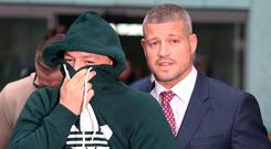 UFC champion Conor McGregor pictured with his Solicitor Graham Kenny (right ) at Blanchardstown District Court yesterday. Pic: Stephen Collins/Collins Photos