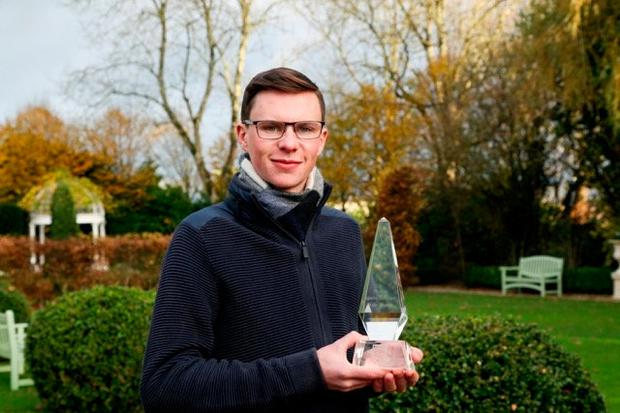 Joseph O'Brien with the Philips Lighting Manager of the Month award for November.