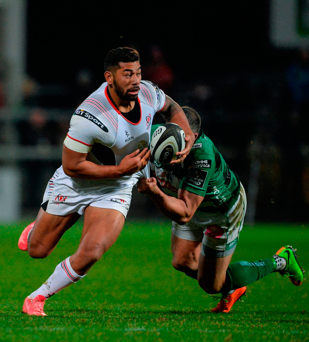 Charles Piutau of Ulster is tackled by Robert Barbieri of Benetton. Photo by Oliver McVeigh/Sportsfile