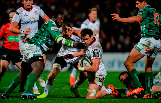 Clive Ross of Ulster is tackled by Cherif Traore of Benetton. Photo by Oliver McVeigh/Sportsfile