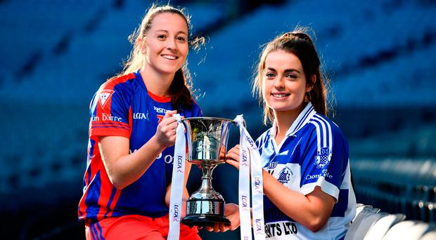 Captains, Annie Moffatt of Dunboyne, left, and Aoife Keating of Kinsale, with the Ladies All-Ireland Intermediate Club Trophy during a LGFA All-Ireland Club Finals Captain's Day at Croke ParK this week. Photo by Sam Barnes/Sportsfile