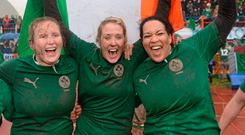 Ireland's Joy Neville (centre), Laura Guest (left) and Lauren Day celebrate after the final whistle of the Six Nations victory over Italy in March 2013. Picture credit: Matt Browne / Sportsfile