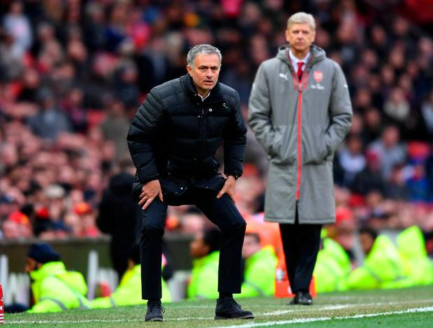 Jose Mourinho with Arsene Wenger looking on. Photo: Michael Regan/Getty Images