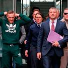 McGregor leaves court with his solicitor Graham Kenny (second from right). Photo: Niall Carson/PA Wire