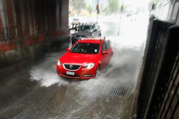 A car drives under the rail bridge on Dudley street in Melbourne on December 1, 2017 in Melbourne, Australia. A severe weather warning has been issued for all of Victoria with the city expected to be lashed with heavy rainfall and potential flooding. (Photo by Darrian Traynor/Getty Images)