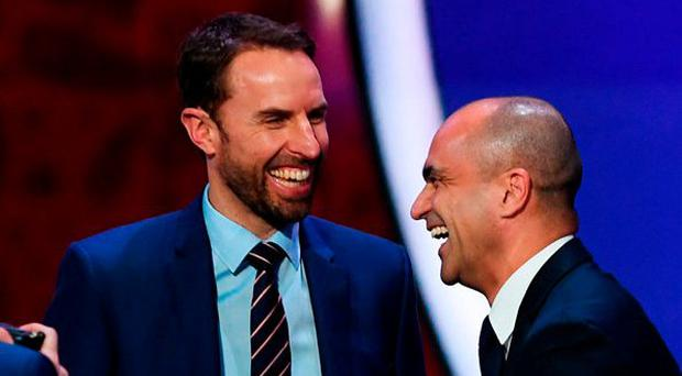 England boss Gareth Southgate is all smiles with Belgium manager Roberto Martinez after they were drawn together in Group G. Photo: Shaun Botterill/Getty Images