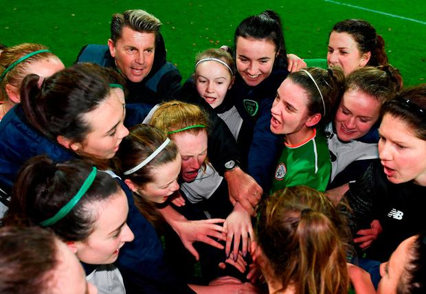 Head coach Colin Bell joins in as as Ireland's players celebrate after drawing their Women's World Cup qualifer against Holland. Photo: Stephen McCarthy/Sportsfile